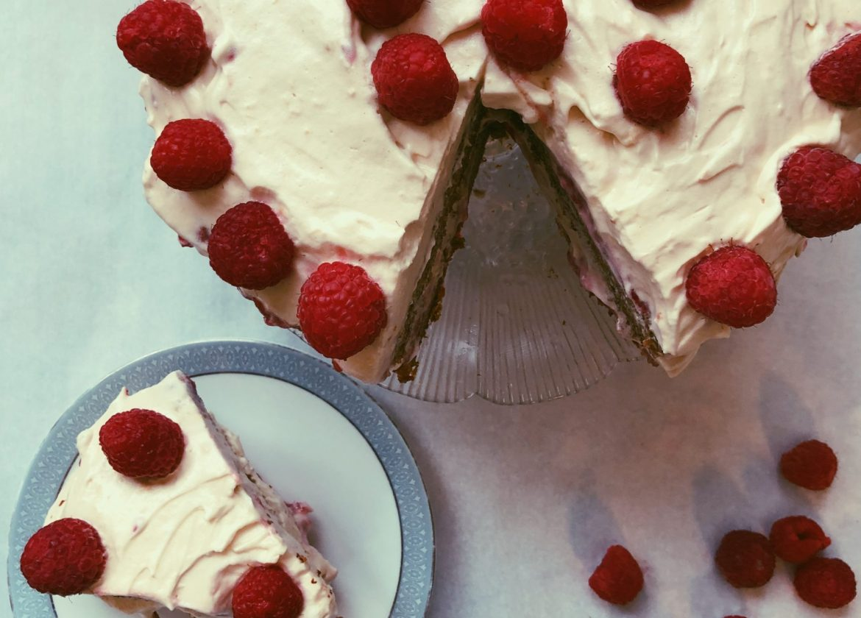 grain free raspberry-infused cake with raspberry jam and honey meringue frosting